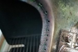 Burner that needs flame ports unclogged